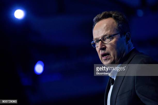 Hinrich Woebcken president and chief executive officer of Volkswagen Group of America Inc speaks during the Automotive News World Congress event in...