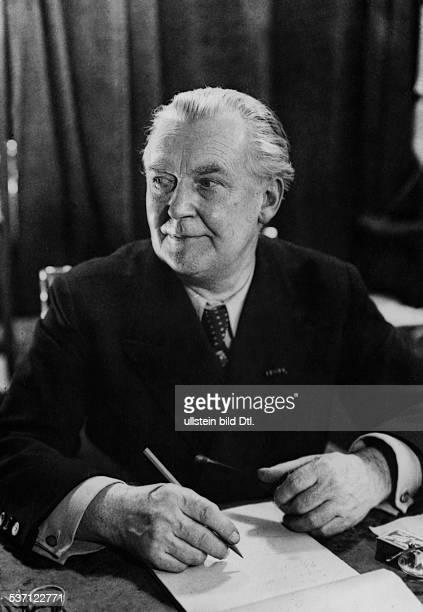 Hinrichs, August - Author, Germany - potrait at his desk - 1944 - Photographer: Presse-Illustrationen Heinrich Hoffmann - Vintage property of...