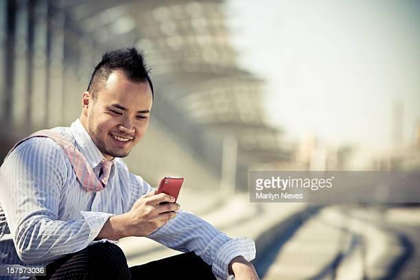 hip asian entrepreneur texting