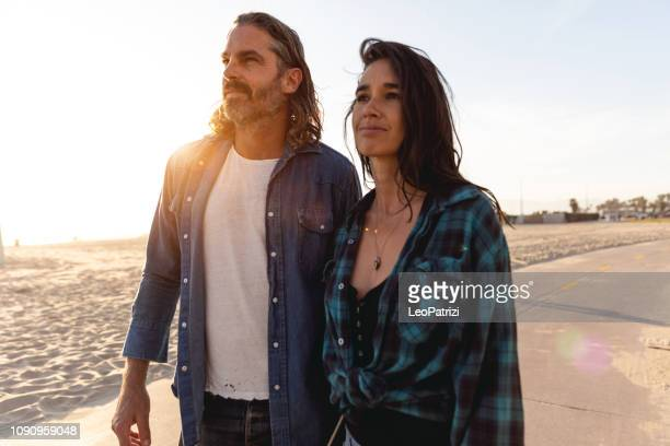 hip couple in venice beach - california - la waterfront stock pictures, royalty-free photos & images