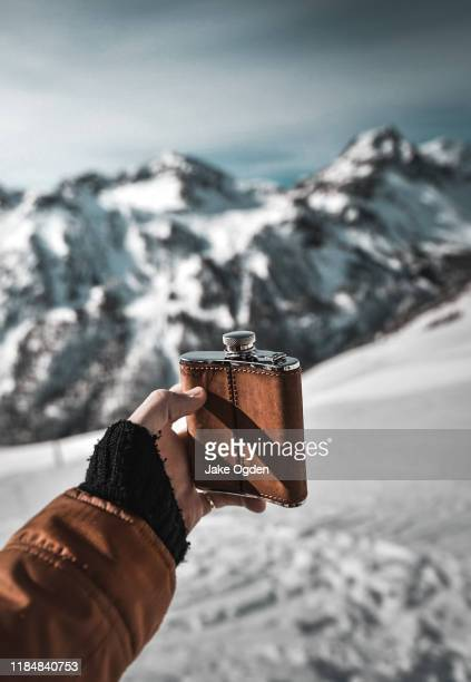 hip flask of whisky in the french alps - flask stock pictures, royalty-free photos & images