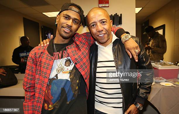 Hip hop artist Big Sean and Kevin Liles attend Power 1051's Powerhouse 2013 presented by Play GIGIT at Barclays Center on November 2 2013 in New York...