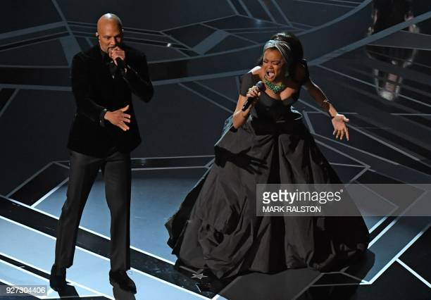 Hip hop artist Common and US singer Andra Day perform during the 90th Annual Academy Awards show on March 4, 2018 in Hollywood, California. / AFP...
