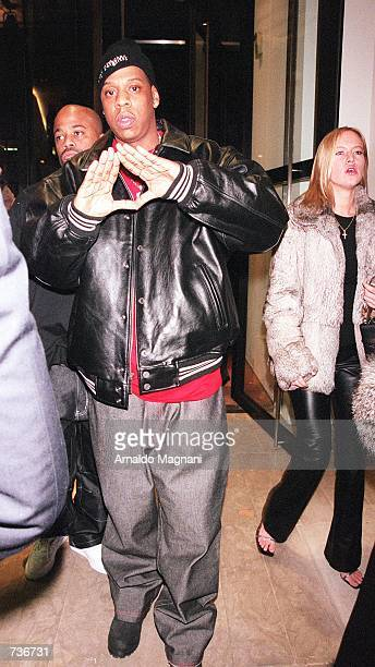 Hip Hop artist JayZ makes a symbolic hand gesture as he enters the Luxury Boutique on Madison Avenue in New York City where Cerrutti presented a new...