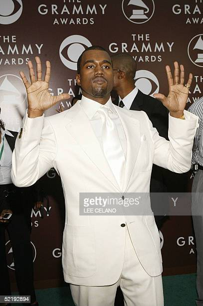 Hip Hop artist Kanye West nominated for Best New Artist poses at the arrivals of the 47th Annual Grammy Awards in Los Angeles CA 13 February 2005 AFP...