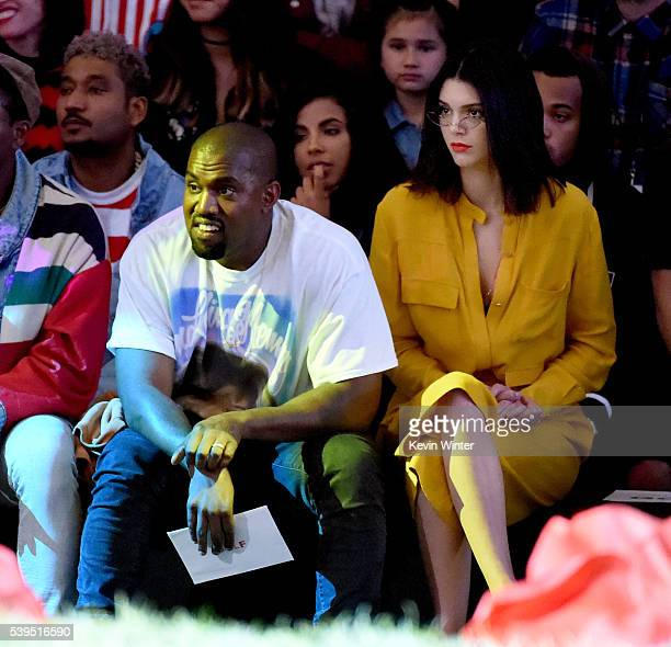 Hip Hop artist producer designer Kanye West and model Kendall Jenner attend Tyler the Creator's fashion show for Made LA at LA Live on June 11 2016...