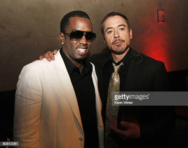 Hip Hop artist Sean Combs and actor Robert Downey Jr pose at the afterparty for the premiere of Paramount's 'Iron Man' at the Roosevelt Hotel on...