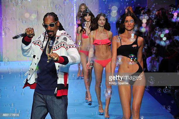 Hip Hop Artist Snoop Dogg performs during the ETAM show as part of the Paris Fashion Week Womenswear Fall/Winter 2015/2016 at Piscine Molitor on...