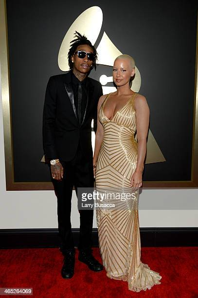 Hip hop artist Wiz Khalifa featured wearing Converse in support of the GRAMMY Foundation's GRAMMY Camp and Amber Rose attend the 56th GRAMMY Awards...