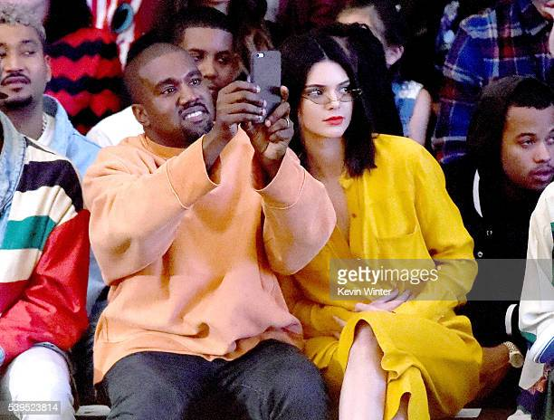Hip hop artist/designer/producer Kanye West and model Kendall Jenner attend Tyler the Creator's fashion show for Made LA at LA Live on June 11 2016...