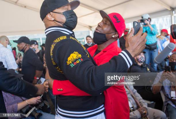 Hip Hop artists LL Cool J and Grand Master Flash greet each other as they attend the ground breaking ceremony for the future Universal Hip Hop Museum...