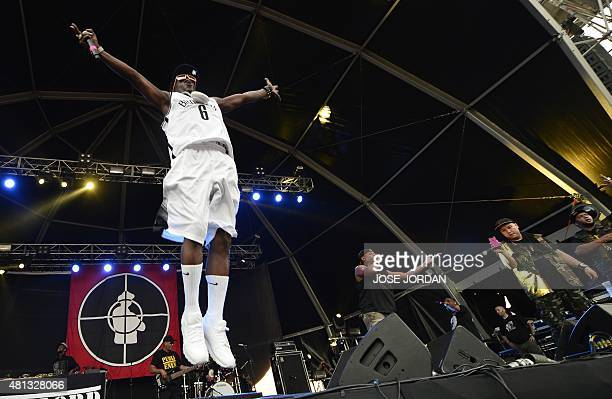 US hip hop band Public Enemy's Flavor Flav jumps on the stage next to Chuck D as they perform during a concert in the Benicassim International...