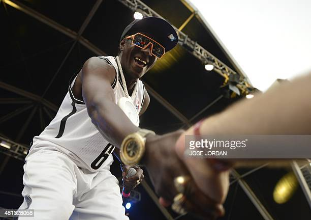 US hip hop band Public Enemy's Flavor Flav shakes hands with a spectator during their concert in the Benicassim International Festival in Benicassim...