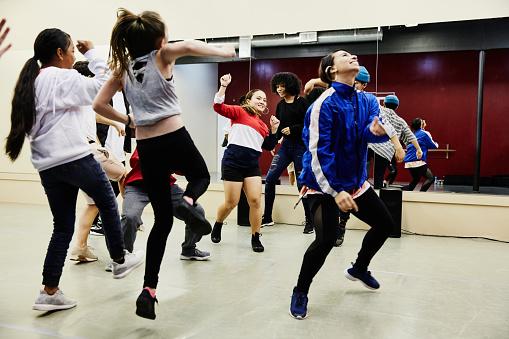 Hip hop dance group dancing together in studio during practice - gettyimageskorea