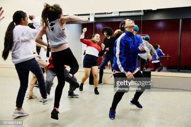 hip hop dance group dancing together in studio during practice - dance troupe stock photos and pictures