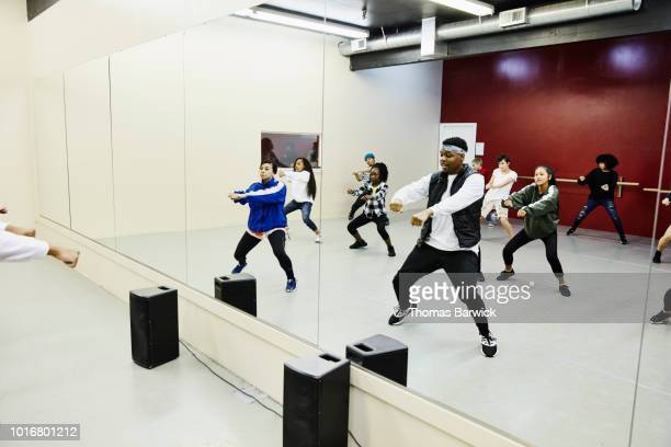 hip hop dance group practicing in dance studio - dance troupe stock photos and pictures