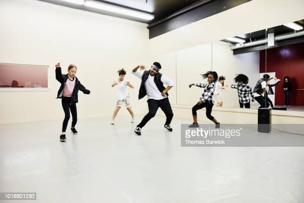 hip hop dance group practicing in dance studio - dance troupe bildbanksfoton och bilder