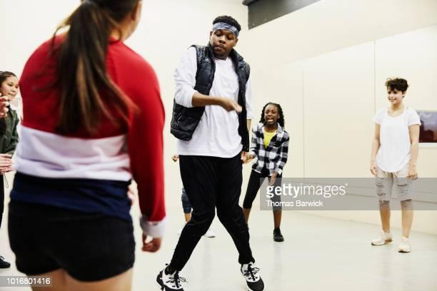 hip hop dance instructor leading class in dance studio - dance troupe bildbanksfoton och bilder
