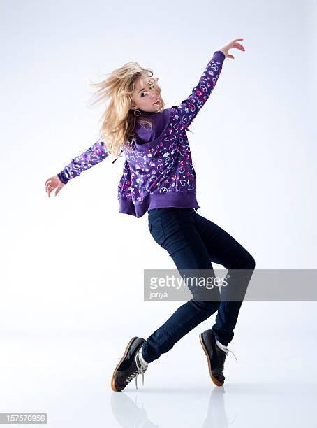 hip hop dancer standing on her toes - dancing silhouette stock pictures, royalty-free photos & images