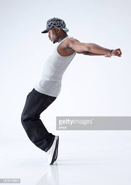 hip hop dancer standing on his toes - breakdancing stock photos and pictures