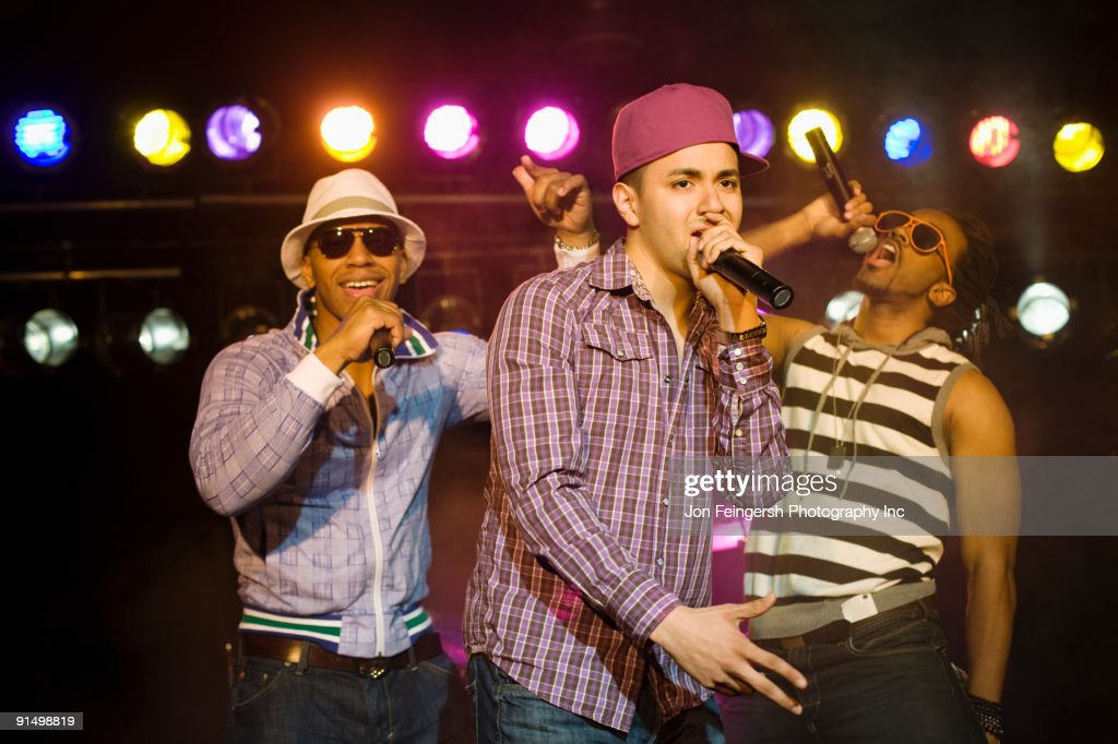 Hip hop musical group performing onstage : Stock Photo