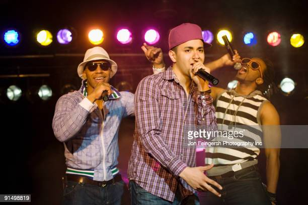 hip hop musical group performing onstage - rap stock pictures, royalty-free photos & images