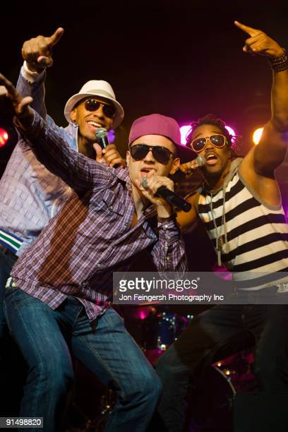 Hip hop musical group performing onstage