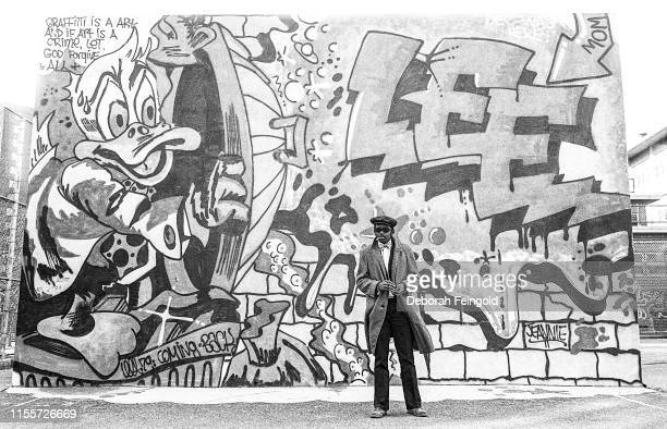Hip Hop pioneer, rapper and visual artist Fab Five Freddy AKA Fred Brathwaite poses for a portrait in front of mural by graffiti artist Lee Quinones...
