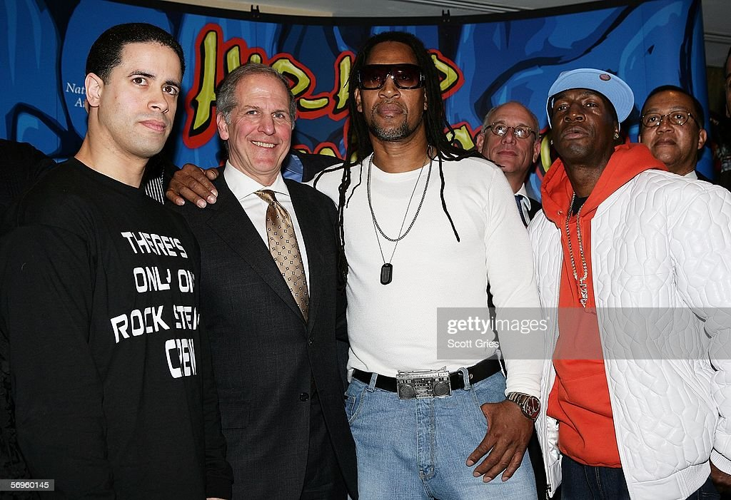 Hip hop pioneers Crazy Legs, Smithsonian American History Director Brent Glass, Kool Herc, and Grandmaster Flash pose for a photo during a press conference to announce the launch of The Smithsonian's 'Hip-Hop Won't Stop: The Beat, The Rhymes, The Life' at the Hilton Hotel February 28, 2006 in New York City.