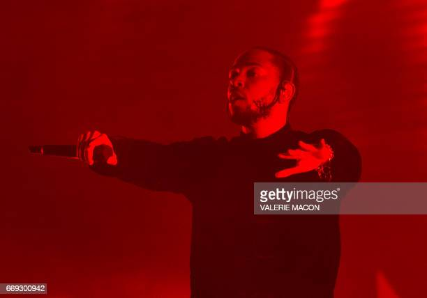 US hip hop singer Kendrick Lamar performs in Coachella Valley Music And Arts Festival on April 16 in Indio California / AFP PHOTO / VALERIE MACON