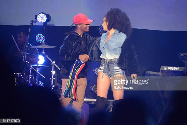 Hip Hop Star Emtee and Pearl Thusi perform during the Castle Lite Unlocks J Cole concert at the Ticketpro Dome on June 18 2016 in Johannesburg South...