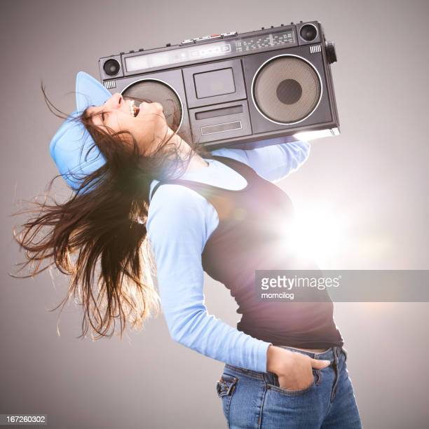 Hip hop style female smiling with boom box