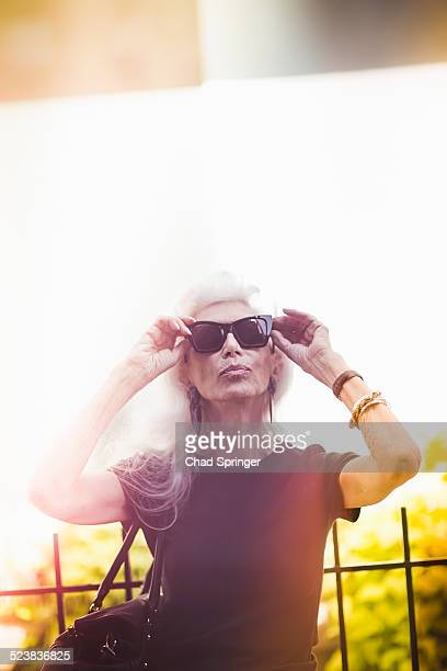 Hip senior woman wearing sunglasses