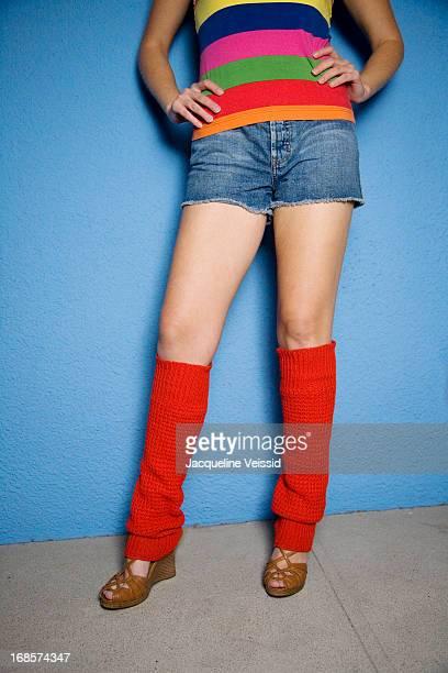 hip woman wearing red leg warmers - レッグウォーマー ストックフォトと画像