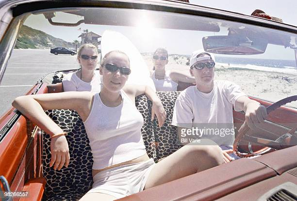 Hip young adults in convertible