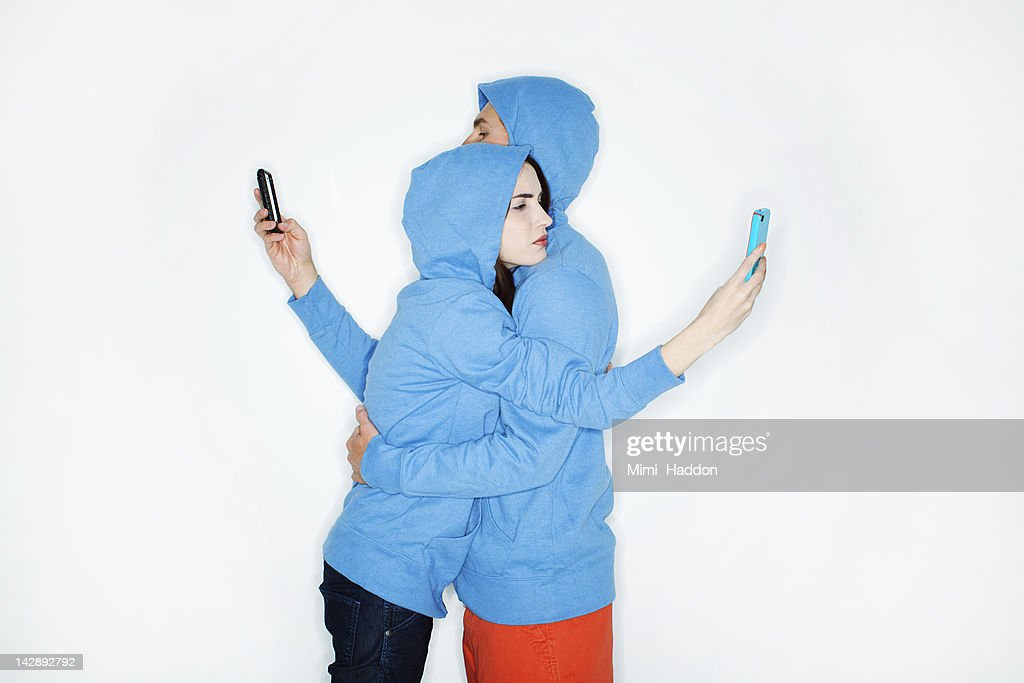 Hip Young Couple Hugging While Reading Texts : Stock Photo