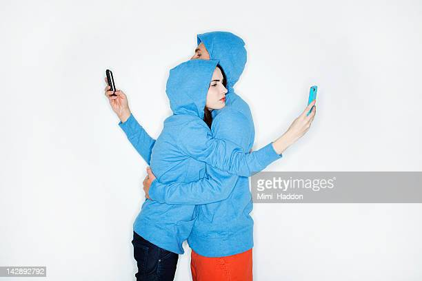 hip young couple hugging while reading texts - addict stock photos and pictures
