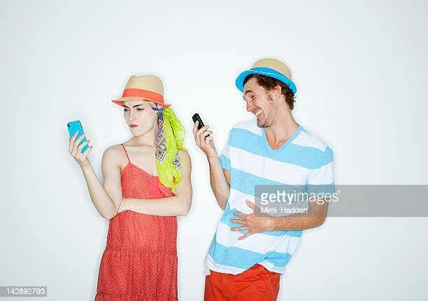 Hip Young Couple Reacting to Text Messages