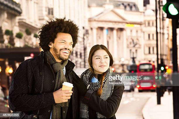 hip young couple visiting london - west end london stock pictures, royalty-free photos & images