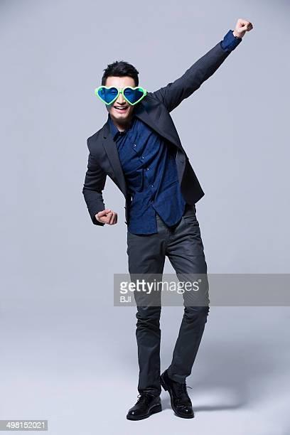 hip young man wearing big sunglasses - flying solo after party bildbanksfoton och bilder