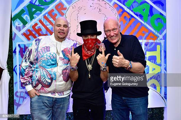 HipHop artis Fat Joe Artist Alec Monopoly and TAG Heuer CEO JeanClaude Biver at TAG Heuer Miami Design District on November 29 2016 in Miami Florida