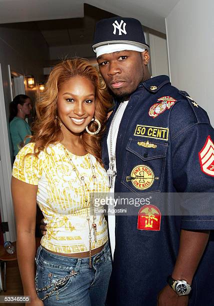 Hiphop artist 50 Cent and singer Olivia appear on MTV's Total Request Live at MTV Studios August 9 2005 in New York City