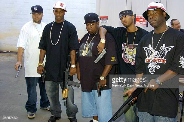 Hiphop artist Cam'Ron and members of the Diplomats his Harlembased rap crew film a scene featuring a shootout at Cinema World Studios in Greenpoint...