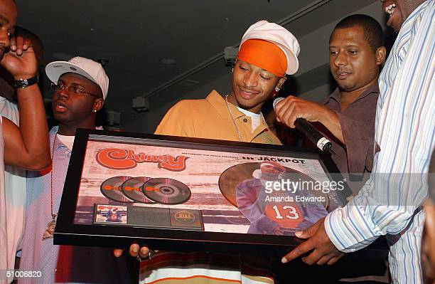Hiphop artist Chingy receives a triple platinum award at Chingy's Triple Platinum ChaChing Party on June 28 2004 at Pearl Nightclub in West Hollywood...