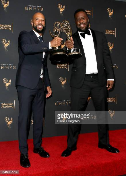 Hiphop artist Common and pianist Robert Glasper pose in the press room with the award for outstanding original music and lyrics for 13th Song Title...