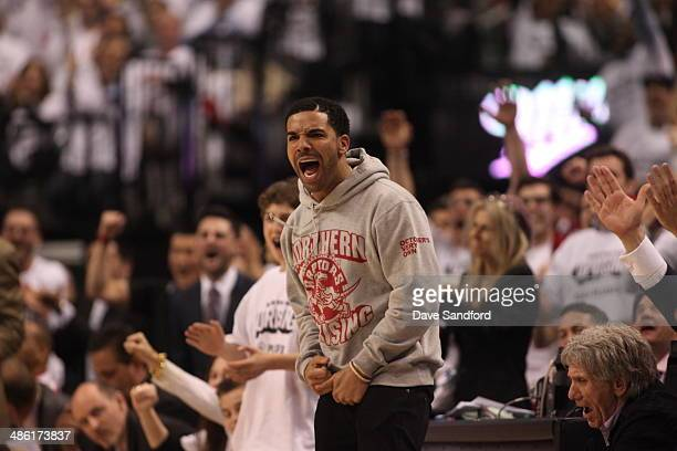 HipHop artist Drake celebrates during Game Two of the Eastern Conference Quarterfinals between the Toronto Raptors and the Brooklyn Nets during the...