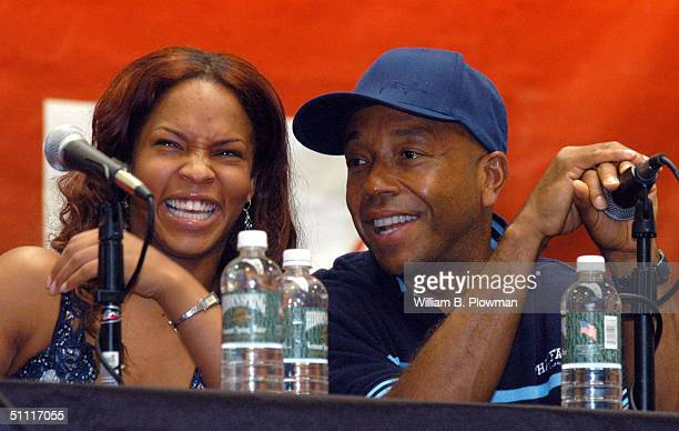 Hip-hop artist Free and Chairman of the Hip-Hop Summit Action Network Russell Simmons share a laugh during a Boston Hip-Hop Summit youth voter...