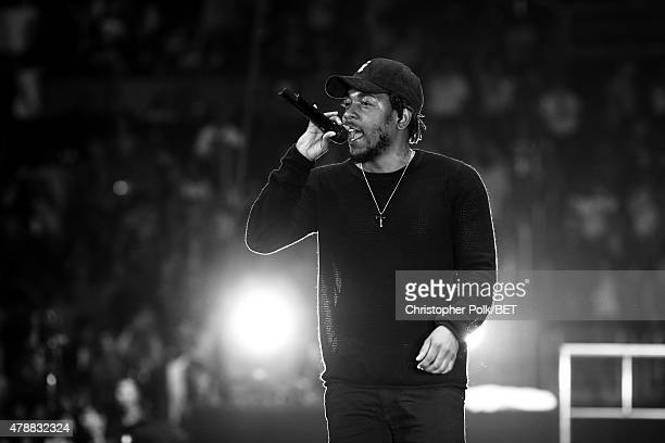 Hiphop artist Kendrick Lamar performs onstage during the Ice Cube Kendrick Lamar Snoop Dogg Schoolboy Q AbSoul Jay Rock concert at Staples Center on...