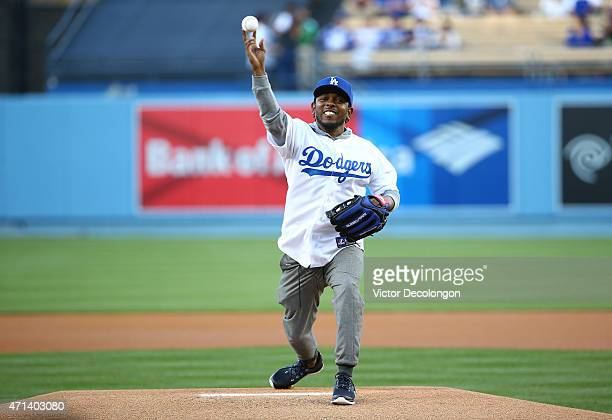 HipHop artist Kendrick Lamar throws out the ceremonial first pitch prior to the MLB game between the San Francisco Giants and the Los Angeles Dodgers...