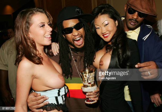 Hiphop artist Lil Jon poses with adult film stars as they arrive at the 2005 AVN Awards on January 8 2005 at the Venetian Hotel in Las Vegas Nevada